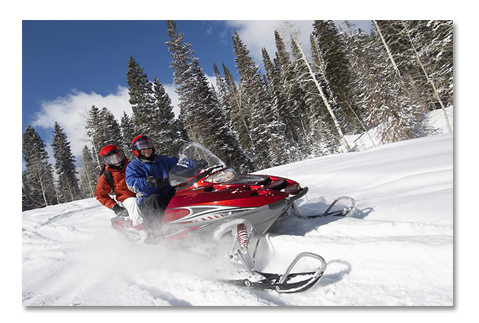 Snowmobile Driving in Snow
